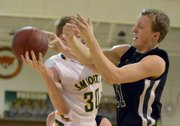 Free State's Weston Hack, right, goes up for a rebound against Shawnee Mission South's Josh Pederson on Tuesday, Jan. 8, 2012, in Overland Park.