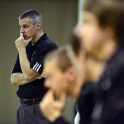 Free State head coach Chuck Law watches the Firebird boys' 65-48 loss to Shawnee Mission South on Tuesday, Jan. 8, 2012, in Overland Park.