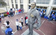 Basketball fans congregate around the Phog Allen statue while waiting for the doors of the fieldhouse to open on Wednesday, Jan. 9, 2013 before the Jayhawks' Big 12 opener against Iowa State.