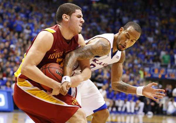 Kansas guard Travis Releford wrestles with Iowa State forward Georges Niang during the second half on Wednesday, Jan. 9, 2013 at Allen Fieldhouse.