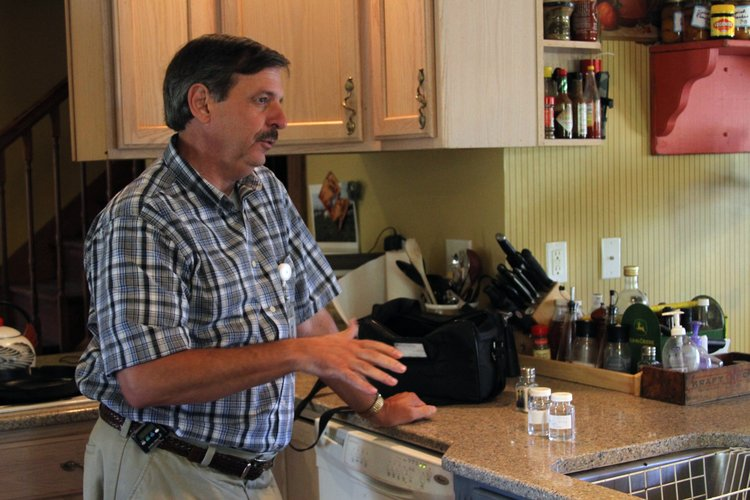 Richard Ziesenis, director of Environmental Health at the Lawrence-Douglas County Health Department, urges residents to test their homes for radon. In this file photo, Ziesenis is testing a home's water system.