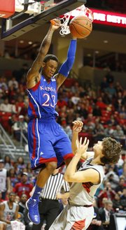 Kansas guard Ben McLemore finishes a put-back dunk over Texas Tech guard Dusty Hannahs during the first half on Saturday, Jan. 12, 2013 at United Spirit Arena in Lubbock, Texas.
