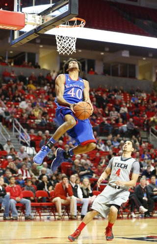 Kansas forward Kevin Young soars in for a reverse jam before Texas Tech guard Ty Nurse during the second half on Saturday, Jan. 12, 2013 at United Spirit Arena in Lubbock, Texas.