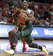 Baylor's Pierre Jackson, front, is fouled by Texas Tech's Daylen Robinson during their game Tuesday in Lubbock, Texas. Jackson, who leads the Big 12 in scoring, and the Bears will meet KU at 8 tonight in a Big Monday showdown in Allen Fieldhouse.