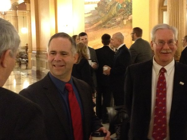 U.S. Rep. Tim Hueslkamp, R-Fowler, (center) visited the Statehouse on Monday.