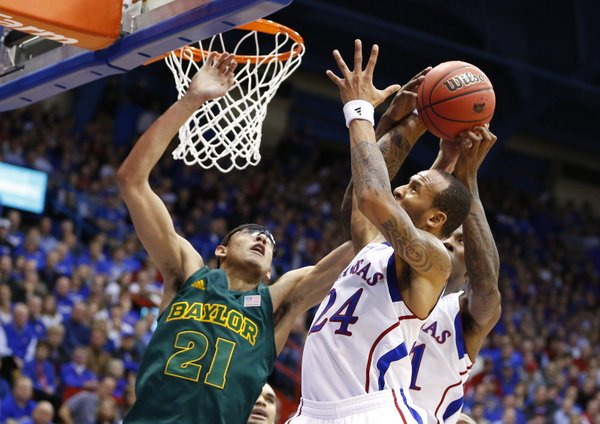 Kansas guard Travis Releford pulls a rebound away from Baylor center Isaiah Austin during the second half on Monday, Jan. 14, 2013 at Allen Fieldhouse.