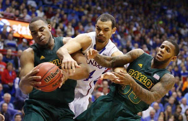 Kansas forward Perry Ellis wrestles for a rebound with Baylor players Rico Gathers, left, and Pierre Jackson during the second half on Monday, Jan. 14, 2013 at Allen Fieldhouse.