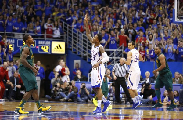 Kansas guard Ben McLemore holds up a three before Baylor guard A.J. Walton after hitting one late in the second half to widen the Jayhawks' lead on Monday, Jan. 14, 2013 at Allen Fieldhouse.