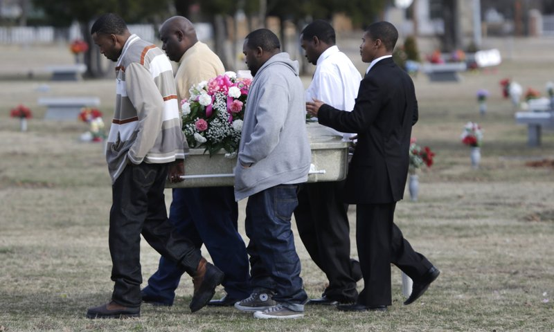 Pallbearers carry the small coffin holding six-year-old Tahlia Johnson on her way to her burial Friday, Jan. 11, 2013, in Dallas. According to Dallas health officials, Tahlia's death on Tuesday, Jan. 8, 2012, was caused by the flu. It's unclear if she'd been vaccinated for the flu. State health officials say cases have been reported in more than half of Texas, and the intensity of flu-like symptoms is high.