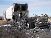 A semi-tractor trailer that caught fire this morning remained on the Kansas Turnpike into the afternoon, after blocking eastbound traffic at mile marker 217, which is 13 miles east of the North Lawrence interchange.