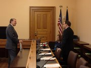Gov. Sam Brownback's Budget Director Steve Anderson speaks with Dave Trabert, president of the Kansas Policy Institute, and state Rep. Amanda Grosserode, R-Lenexa, before Anderson's presentation on the governor's budget proposal.