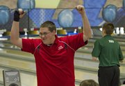 Lawrence High's Connor Daniels celebrates a strike during a Lawrence High bowling invitational Thursday, Jan. 17, 2013, at Royal Crest Lanes.