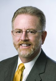 Keith Pickus, interim provost professor of modern German and European history at Wichita State University, is the first candidate announced for the executive vice chancellor job at the Kansas University Edwards Campus in Overland Park.