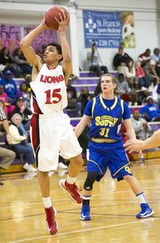 Lawrence High sophomore Anthony Bonner (15) makes a move past David Nelson during Lawrence High's semi-final round game against Olathe South in the Topeka Invitational Tournament, Friday, Jan. 18, 2013 at Topeka West High School. With the 45-41 victory, the Lions advanced to the championship game, which starts tomorrow at approximately 5:15 p.m.