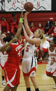 Senior Bri Anderson (5) launches a shot in the Lawrence Lions home win over Wyandotte High Friday, Jan. 18, 2013.