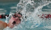 Lawrence High freshman Elliott Abromeit competes in the 50-yard freestyle on Thursday, Jan. 17, 2013, at Knox Natatorium. The Lions placed second at their only home meet of the season.