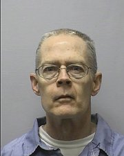 Former Kansas State University English professor Thomas E. Murray, 56, was convicted in the 2003 murder of his ex-wife north of Lawrence. He is challenging his sentence Tuesday in a civil case in Douglas County District Court.