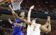 Kansas guard Travis Releford gets a bucket past Texas players Demarcus Holland and Ioannis Papapetrou during the first half on Saturday, Jan. 19, 2013 at Frank Erwin Center in Austin, Texas.