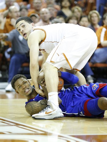 Kansas guard Ben McLemore and Texas guard Javan Felix look for a possession call from a game official during the second half on Saturday, Jan. 19, 2013 at Frank Erwin Center in Austin, Texas.