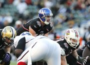 National team quarterback Dayne Crist (10) of Kansas calls out a play during the NFLPA Collegiate Bowl on Saturday, Jan. 19, 2013 in Carson, Calif. (Ric Tapia/AP Images for NFLPA)