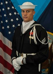 Philip Sierra is pictured in his full U.S. Navy uniform.