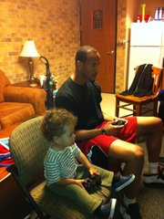 T.J. Releford plays video games with his dad, Travis Releford.
