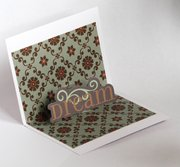 Make homemade pop-up cards like these using scrapbook paper and accoutrements.