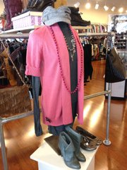 Adding a colorful sweater or scarf is an easy way to brighten up a wintry neutral piece, like this gray dress at Ditto Resale Boutique. Color not only changes the look of your outfit, it can flatter your face as well.