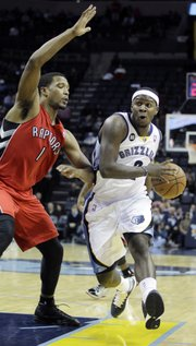 In this Nov. 28, 2012, file photo, Memphis Grizzlies guard Josh Selby (2) works the ball against Toronto Raptors forward Dominic McGuire (1) during the second half of an NBA basketball game in Memphis, Tenn. The Grizzlies have agreed to trade Selby, Marreese Speights, Wayne Ellington, and a future first-round draft pick to the Cleveland Cavaliers for Jon Leuer on Tuesday, Jan. 22, 2013.