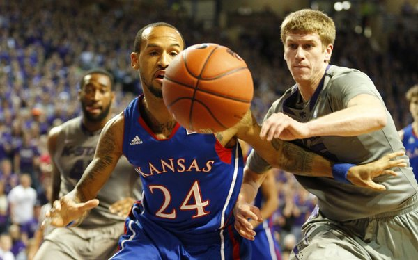Kansas guard Travis Releford competes for a loose ball with Kansas State guard Will Spradling during the first half on Tuesday, Jan. 22, 2013 at Bramlage Coliseum.