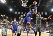 Kansas guard Ben McLemore goes in for a bucket between Kansas State defenders Jordan Henriquez (21) and Rodney McGruder (22) during the second half on Tuesday, Jan. 22, 2013 at Bramlage Coliseum. Also pictured are Kansas center Jeff Withey (5) and Kansas State guard Shane Southwell.