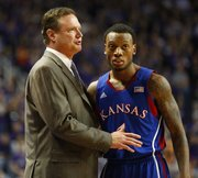 Kansas head coach Bill Self talks with guard Naadir Tharpe during a break in action against Kansas State on Tuesday, Jan. 22, 2013 at Bramlage Coliseum.