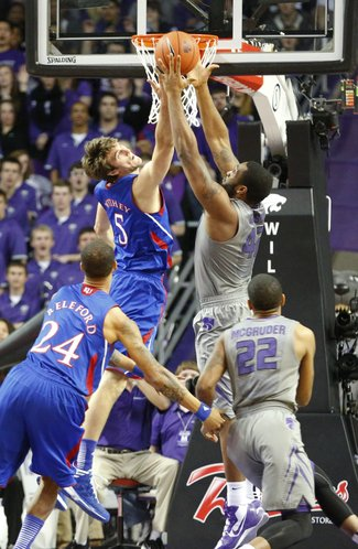 Kansas center Jeff Withey competes for a rebound with Kansas State forward Thomas Gipson during the first half on Tuesday, Jan. 22, 2013 at Bramlage Coliseum.