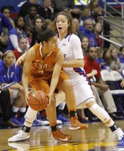 Monica Engelman (13) puts defensive pressure on Texas guard Celina Rodrigo (2) during the Jayhawks game against the Texas Longhorns Wed, Jan. 23, 2013, at Allen Fieldhouse.