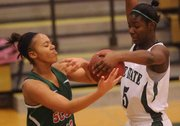 Free State sophomore Ilene Tolbert, right, gets a hand on the ball for a steal against Highland Park's Destini Gillian (12) on Thursday, Jan. 24, 2013, at FSHS.