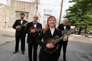 In honor of its 40th anniversary, the Uptown Mandolin Quartet will give a free concert this week. Group members are, from left, Mike Stewart, Charles Higginson, Beth Dearinger and Jeff Dearinger.