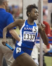 Kansas University track star Diamond Dixon runs in the 4x400 event at the Jayhawk Classic on Friday, Jan. 25, 2013, at Anschutz Pavilion.