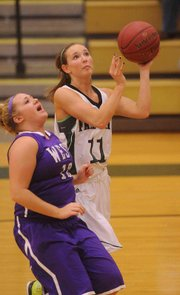 Free State senior Kennedy Kirkpatrick, right, goes up for two against Topeka West's Joele Copeland during the Free State girls' 58-24 semifinal victory on Friday, Jan. 25, 2013, in the Firebird Winter Classic at FSHS. Kirkpatrick scored a game-high 16 points.