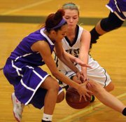Free State senior Abbey Casady, right, steals the ball from Topeka West's Shania Giardin during the FSHS girls' 58-24 victory on Friday, Jan. 25, 2013, at the Firebird Winter Classic at FSHS.