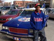Terrell Miller, of Wichita, was in town for the men's basketball game Saturday with his 1989 Chevy Caprice Classic. He's been working on the car's paint job and decals for about a year, and said he received a lot of attention from KU fans around town.