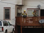 Lawrence-Douglas County Fire Medical crews respond to a fire at a house in the 900 block of Indiana Street Saturday morning about 8 a.m. There were no injuries and the fire was under control by 9 a.m.