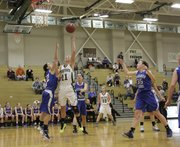 Kennedy Kirkpatrick (11) shoots a hook shot from below the basket for two points in the Free State Firebirds win over Washburn Rural in the championship game of the Firebirds Winter Classic Saturday at FSH.