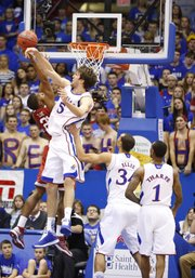 Kansas center Jeff Withey blocks a shot from Oklahoma guard Cameron Clark during the first half on Saturday, Jan. 26, 2013 at Allen Fieldhouse.