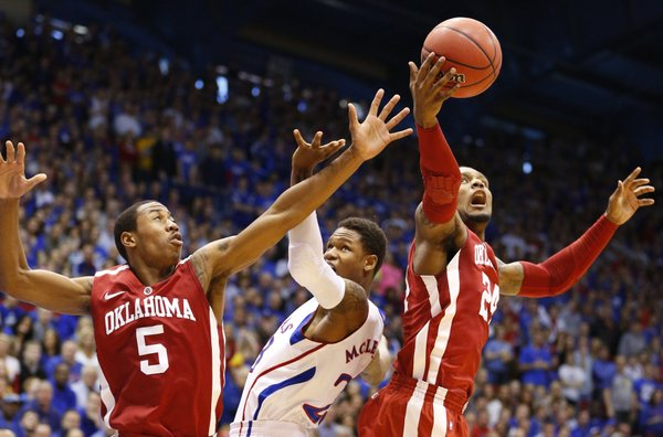 Kansas guard Ben McLemore loses a rebound to Oklahoma forward Romero Osby, right, during the first half on Saturday, Jan. 26, 2013 at Allen Fieldhouse. At left is Oklahoma guard Je'lon Hornbreak.