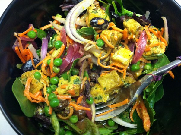 Salad of mixed greens, curry tofu, picked red onions, raw red onions, peas, olives, marinated mushrooms, roasted veggies, carrots, raisins and balsamic dressing.