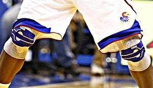 Close Up of EJ's Knees in the OU Game. Photo by Nick Krug/cropping and enlargement by jaybate