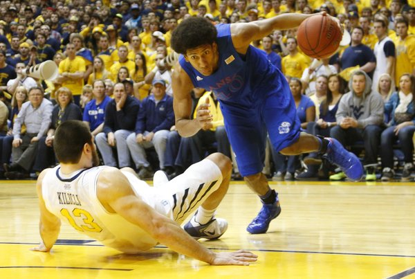 Kevin Young (40) drives the baseline on Deniz Kilicli (13) in the Jayhawks 61-56 win against the Mountaineers Monday night at West Virginia University.