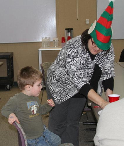Jenn Preston, supervisor of Healthy Families Douglas County, visits with Jaden Powell during the program's annual Holiday Party on Dec. 18, 2012.