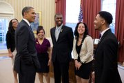 President Barack Obama greets representatives of the Boys and Girls Club of America, including Trei Dudley of Lawrence, in the Oval Office on Monday.
