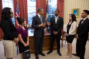 President Barack Obama talks with representatives of the Boys and Girls Club of America, including Trei Dudley of Lawrence (far left), in the Oval Office on Monday.